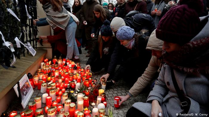 People put candles outside the Slovak embassy in Prague