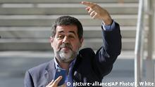 Jordi Sanchez, president of the pro-independence Catalan National Assembly leaves the national court during a break in Madrid, Spain, in Madrid, Spain, Monday, Oct. 16, 2017. Trapero, another regional police offer and the leaders of two pro-independence associations are under investigation for sedition for their roles in Sept. 20-21 demonstrations in Barcelona as Spanish police arrested several Catalan officials and raided offices in a crackdown on referendum preparations. (AP Photo/Paul White)  