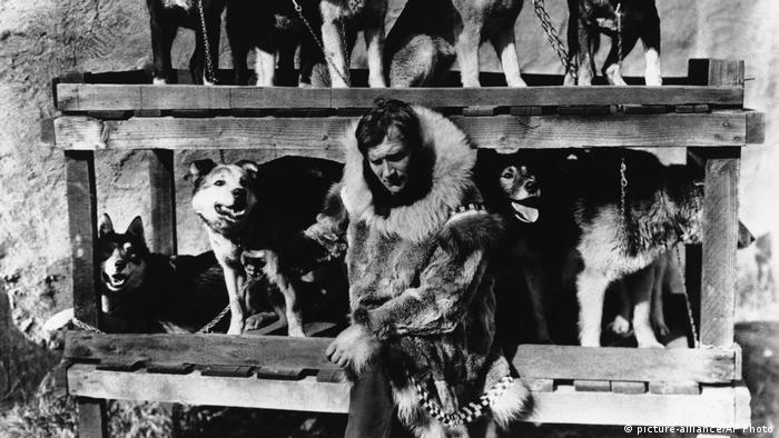 Gunnar Kaasen poses with his original dog team which he drove through a blinding blizzard to Nome, Alaska to deliver an diphtheria serum to save the town from being wiped out by the disease in 1925.