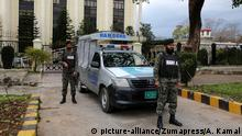 Pakistani Rangers guard the parliament building during senate elections in Islamabad.