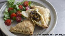 This July 28, 2014 photo shows easy mushroom and sweet potato turnovers in Concord, N.H. These earthy, hearty turnovers work equally well as a fall gathering appetizer and an easy weeknight meal. (AP Photo/Matthew Mead) |