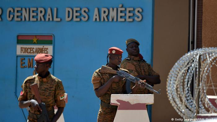 Burkinabe soldiers patrol the army's headquarters in Ouagadougou