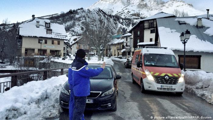 An ambulance transports avalanche victims to hospital.