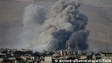 DAMASCUS, SYRIA - MARCH 02: Smoke rises after Assad Regime's airstrike hit residential areas in Eastern Ghouta, Damascus, Syria on March 02, 2018. The UN Security Council on February 24 adopted a resolution calling for a 30-day cease-fire in Syria to allow for humanitarian aid deliveries. The cease-fire decision came as regime forces intensified attacks on Eastern Ghouta in recent days, killing 23 people more added to several hundred others. Samir Tatin / Anadolu Agency  