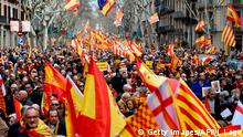 People hold Spanish flags during a pro-unity rally organized by the Tabarnia movement, a fictional region that wants independence from Catalonia, on March 04, 2018 in Barcelona. / AFP PHOTO / Josep LAGO (Photo credit should read JOSEP LAGO/AFP/Getty Images)
