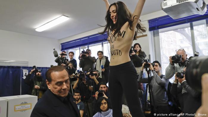 Femen activist in front of Berlusconi