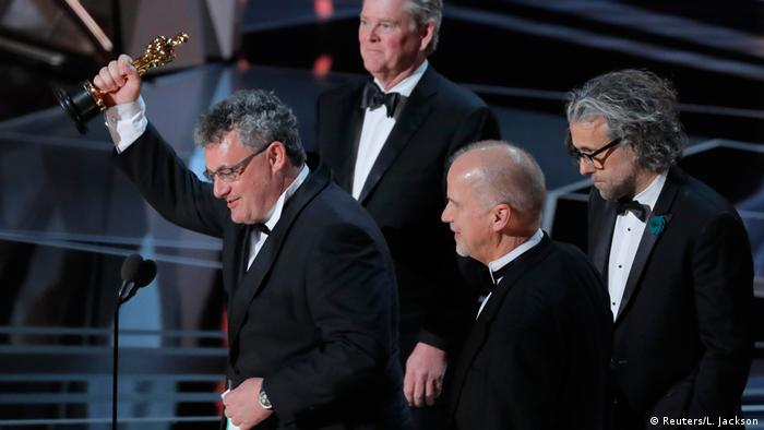 Four men receiving award for Best Visual Effects on stage (Reuters/L. Jackson)