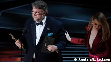 90th Academy Awards - Oscars Show - Hollywood, California, U.S., 04/03/2018 - Guillermo del Toro accepts the Oscar for Best Director for The Shape of Water from presenter Emma Stone (R). REUTERS/Lucas Jackson