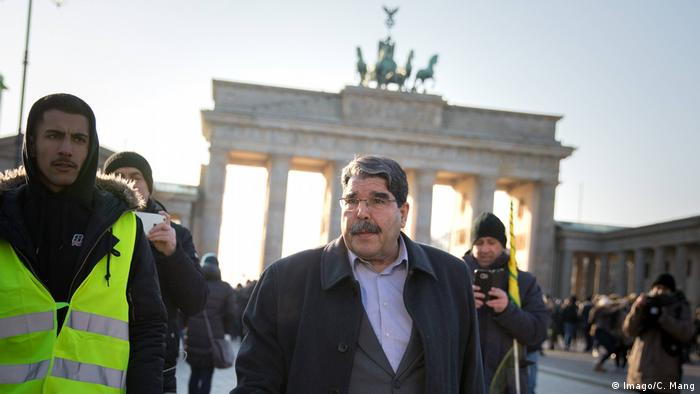 Syrian Kurdish leader Salih Muslim in front of the Brandenburg Gate in Berlin