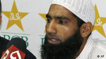 Pakistani cricketer Mohammad Yousuf, right, addresses a news conference