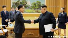 North Korean leader Kim Jong Un greets Chung Eui-yong, head of the presidential National Security Office, in Pyongyang, North Korea