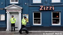 06.03.2018 +++ A police officer stands outside a restaurant which was closed after former Russian inteligence officer Sergei Skripal, and a woman were found unconscious on a bench nearby after they had been exposed to an unknown substance, in Salisbury, Britain, March 6, 2018. REUTERS/Toby Melville