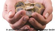 Hands cup euro coins