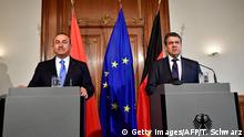 German Vice Chancellor and Foreign Minister Sigmar Gabriel (R) and Turkish Foreign Minister Mevlut Cavusoglu give a joint press conference during a meeting on March 6, 2018 in Berlin. / AFP PHOTO / Tobias SCHWARZ (Photo credit should read TOBIAS SCHWARZ/AFP/Getty Images)