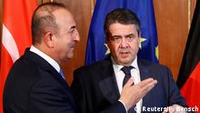 06.03.2018 *** Turkish Foreign Minister Mevlut Cavusoglu and his German counterpart Sigmar Gabriel after a statement in Berlin, Germany, March 6, 2018. REUTERS/Fabrizio Bensch