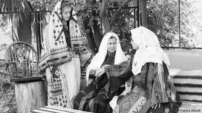Three women in traditional dresses (Fatima Abbadi)