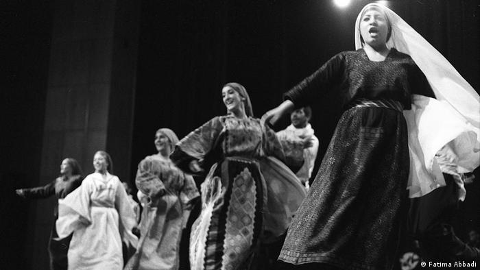 Palestinian women dancing in traditional costumes (Fatima Abbadi)