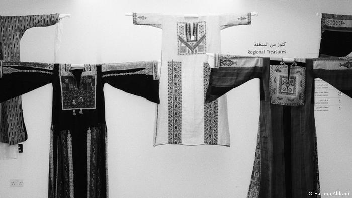 Traditional dresses hanging in a museum (Fatima Abbadi)