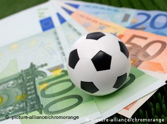 soccer ball on a pile of euro notes