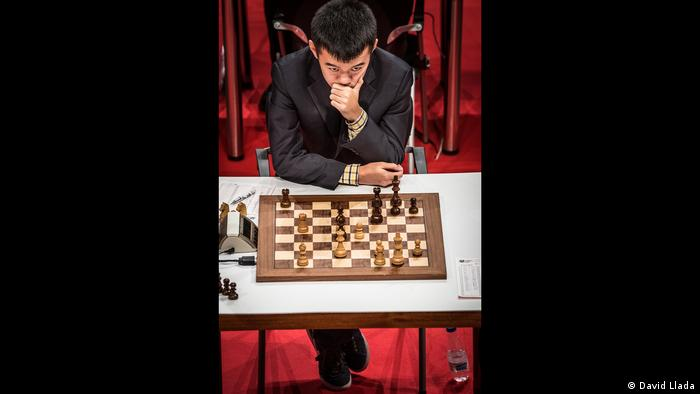 A birds-eye view of Ding Liren in front of a chess board (Photo: David Llada)