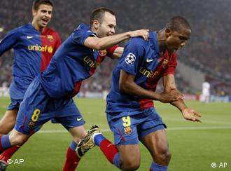 Barcelona's Samuel Eto'o, right, celebrates joined by his teammate Andres Iniesta after scoring during the UEFA Champions League final soccer match between Manchester United and Barcelona in Rome.