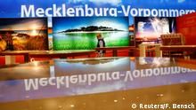 A worker makes final touches at the booth of the German federal state of Mecklenburg-Vorpommern (Mecklenburg-West Pomerania) at the International Tourism Trade Fair ITB in Berlin, Germany March 6, 2018. REUTERS/Fabrizio Bensch