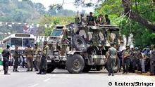 Sri Lanka's army soldiers stand guard a road after a clash between two communities in Digana, central district of Kandy, Sri Lanka March 6, 2018. REUTERS/Stringer NO RESALES. NO ARCHIVES.
