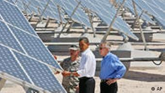 President Obama, and Senate Majority Leader Harry Reid look at solar panels at Nellis Air Force Base in Nevada, May 27, 2009