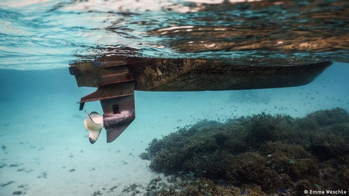 A motorboat, seen from beneath the surface of water