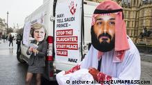 Campaigners wearing masks of Saudi Crown Prince Salman and PM May protest against the sale of British weapons to Saudi Arabia