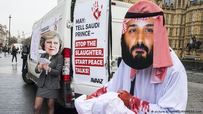 British protesters don masks of Theresa May and Saudi Crown Prince Mohammad bin Salman to protest British arms sales to Saudi Arabia.