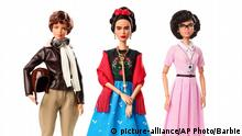 An image released by Barbie shows dolls in the image of pilot Amelia Earhart, left, Mexican artist Frida Khalo and mathematician Katherine Johnson, part of the Inspiring Women doll line series