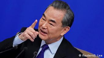 Wang Yi points his finger as he speaks (Reuters/J. Lee)