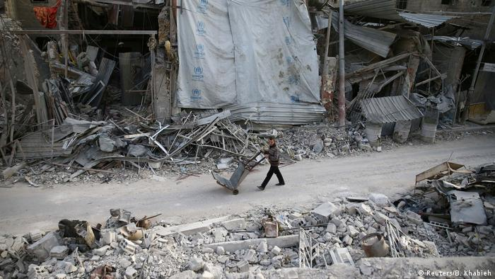 A child walks through destroyed eastern Ghouta