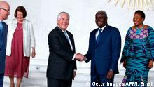 African Union (AU) Commission Chairman Moussa Faki (2-R), of Chad, and US Secretary of State Rex Tillerson (3-R) shake hands after their meeting at AU headquarters in Addis Ababa, Ethiopia March 8, 2018. / AFP PHOTO / POOL / JONATHAN ERNST (Photo credit should read JONATHAN ERNST/AFP/Getty Images)