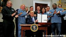 US President Donald Trump signs a proclamation to establish tariffs on imports of steel and aluminium (Reuters/Leah Millis )