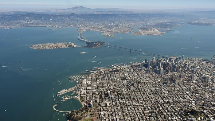 The Golden Gate Bridge and the San Francisco Bay are seen from above in San Francisco, California