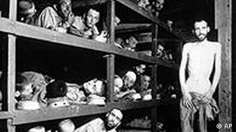 Emaciated men in the Buchenwald barracks in April 1945