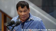 Philippine President Rodrigo Duterte addresses Filipino Overseas Workers who were repatriated from Kuwait, Tuesday, Feb. 13, 2018 at the Ninoy Aquino International Airport in suburban Pasay city southeast of Manila, Philippines. Human rights groups condemned the Philippine president Tuesday for his remarks about troops shooting female communist rebels in the genitals to render them useless, which they said can encourage sexual violence and war crimes. The left-wing group Karapatan said President Rodrigo Duterte has distinguished himself as a frothing-in-the-mouth fascist who incites the worst violations of international humanitarian law. (AP Photo/Bullit Marquez)  