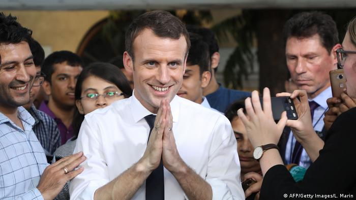 Emmanuel Macron gestures at Bikaner House in New Delhi