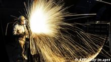 A Chinese worker cutting steel in Qingdao in China's eastern Shandong province