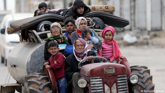 Syrians flee the village of Khaldieh in Afrin (Reuters/K. Ashawi)