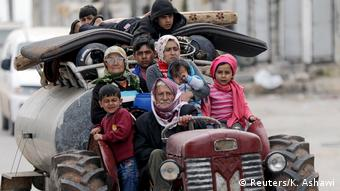 People fleeing from Afrin (Reuters/K. Ashawi)
