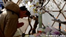 11.03.2018 *** Participants attend a moment of silence at 2:46 p.m. (0546 GMT), the time when the magnitude 9.0 earthquake struck off Japan's coast in 2011, during a rally in Tokyo, Japan March 11, 2018, to mark the seventh-year anniversary of the earthquake and tsunami that killed thousands and set off a nuclear crisis. REUTERS/Toru Hanai
