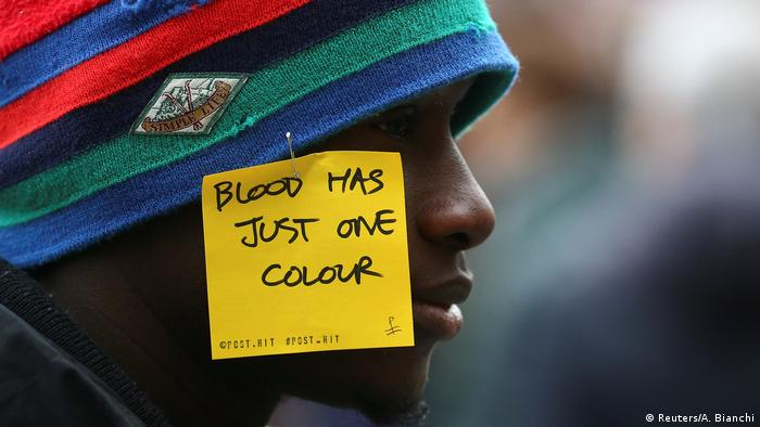 A man at a rally against racism in Florence (Reuters/A. Bianchi)