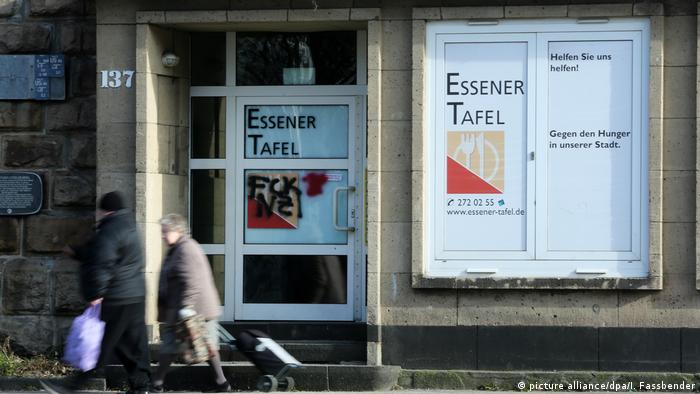 Two people walk in front of aTafel location in Essen