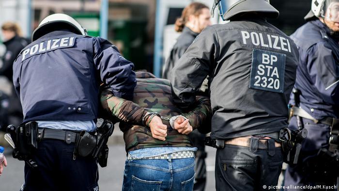 Police taking away a man