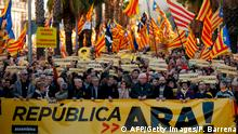 Demonstrators hold a banner reading Republic now! and wave Catalan pro independence 'Estelada' flags as they protest to demand a Catalan republic, called by the pro-independence Catalan National Assembly (ANC) citizens' group in Barcelona on March 11, 2018. Catalonia's separatist push has triggered Spain's worst crisis in decades. / AFP PHOTO / Pau Barrena (Photo credit should read PAU BARRENA/AFP/Getty Images)
