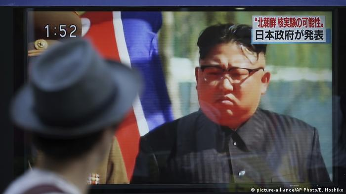 A man watched a TV news program showing an image of North Korean leader Kim Jong Un