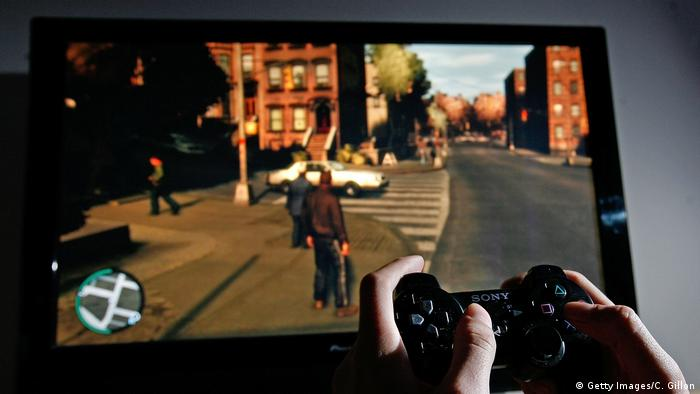 GTA (Grand Theft Auto) on a screen with a controller (Photo by Cate Gillon/Getty Images)